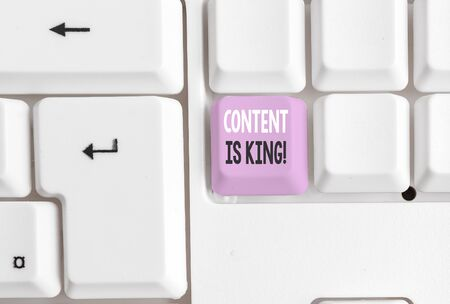 Text sign showing Content Is King. Business photo showcasing marketing focused growing visibility non paid search results White pc keyboard with empty note paper above white background key copy space