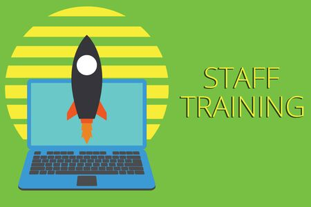 Writing note showing Staff Training. Business concept for A program that helps employees to learn specific knowledge Launching rocket up laptop Startup Developing goal objective