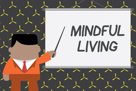 Text sign showing Mindful Living. Business photo showcasing Fully aware and engaged on something Conscious and Sensible Businessman standing in front projector screen pointing project idea 版權商用圖片