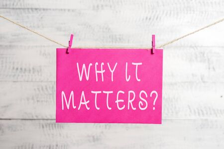 Word writing text Why It Matters Question. Business photo showcasing most important thing to be done when involved in situation Clothesline clothespin rectangle shaped paper reminder white wood desk 免版税图像
