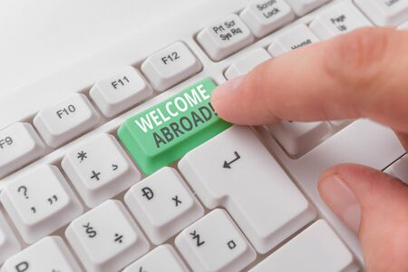Word writing text Welcome Abroad. Business photo showcasing something that you say when someone gets on ship White pc keyboard with empty note paper above white background key copy space
