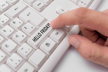 Text sign showing Hello Friday. Business photo showcasing used to express happiness from beginning of fresh week White pc keyboard with empty note paper above white background key copy space