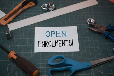 Handwriting text Open Enrolments. Conceptual photo when employees may make changes to elected fringe benefit Carpentry equipments and plain paper scattered everywhere on measuring mat Stock fotó