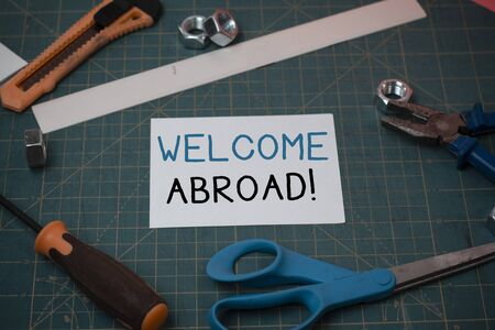 Handwriting text Welcome Abroad. Conceptual photo something that you say when someone gets on ship Carpentry equipments and plain paper scattered everywhere on measuring mat Stockfoto