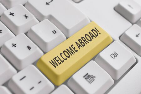 Conceptual hand writing showing Welcome Abroad. Concept meaning something that you say when someone gets on ship White pc keyboard with note paper above the white background Stockfoto