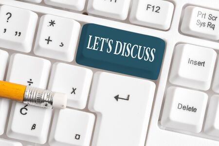 Handwriting text Let S Discuss. Conceptual photo asking someone to talk about something with demonstrating or showing White pc keyboard with empty note paper above white background key copy space