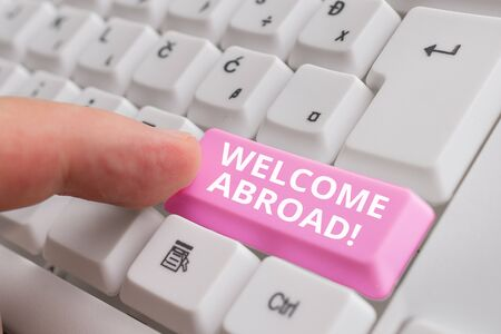 Handwriting text Welcome Abroad. Conceptual photo something that you say when someone gets on ship White pc keyboard with empty note paper above white background key copy space