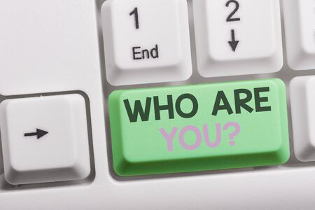 Text sign showing Who Are You question. Business photo showcasing asking demonstrating identity or demonstratingal information White pc keyboard with empty note paper above white background key copy space Imagens