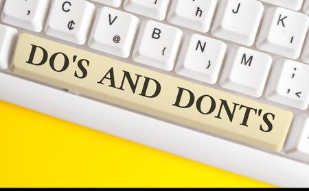 Handwriting text writing Do S Is And Dont S Is. Conceptual photo advising Rules or customs concerning some activity White pc keyboard with empty note paper above white background key copy space Foto de archivo - 128357967