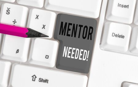 Handwriting text Mentor Needed. Conceptual photo Employee training under senior assigned act as advisor White pc keyboard with empty note paper above white background key copy space Banque d'images