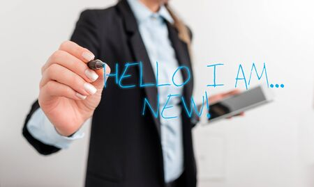 Writing note showing Hello I Am New. Business concept for used as greeting or to begin telephone conversation Digital business in black suite concept with business woman