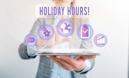 Writing note showing Holiday Hours. Business concept for Overtime work on for employees under flexible work schedules Stock Photo