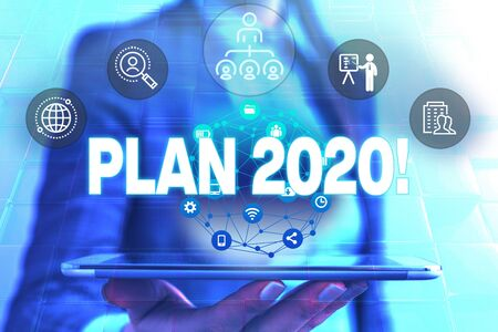 Conceptual hand writing showing Plan 2020. Concept meaning detailed proposal for doing or achieving something next year Female human wear formal work suit presenting smart device
