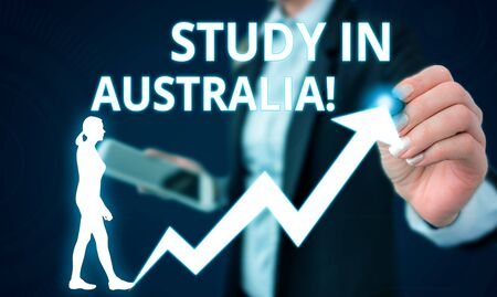 Conceptual hand writing showing Study In Australia. Concept meaning going into foreign country order complete your studies Female human wear formal work suit presenting smart device