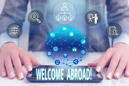 Conceptual hand writing showing Welcome Abroad. Concept meaning something that you say when someone gets on ship Female human wear formal work suit presenting smart device