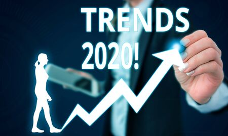 Conceptual hand writing showing Trends 2020. Concept meaning general direction in which something is developing or changing Female human wear formal work suit presenting smart device