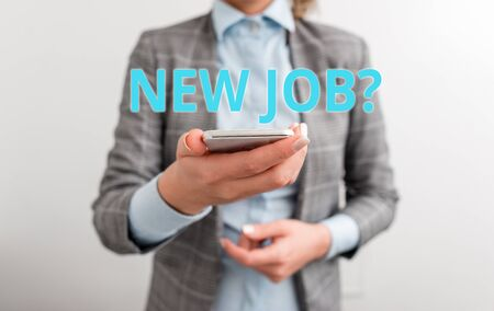 Word writing text New Job Question. Business photo showcasing formal meeting which someone asked find out if they are suitable Business concept with mobile phone and business woman 写真素材 - 128358489