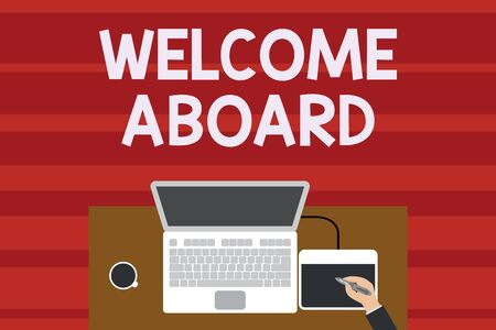 Text sign showing Welcome Aboard. Business photo text Expression of greetings to a demonstrating whose arrived is desired Upper view laptop wooden desk worker drawing tablet coffee cup office