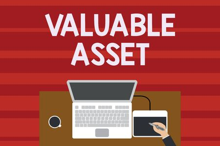 Text sign showing Valuable Asset. Business photo text Your most valuable asset is your ability or capacity Upper view laptop wooden desk worker drawing tablet coffee cup office