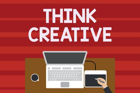 Text sign showing Think Creative. Business photo text The ability to perceive patterns that are not obvious Upper view laptop wooden desk worker drawing tablet coffee cup office