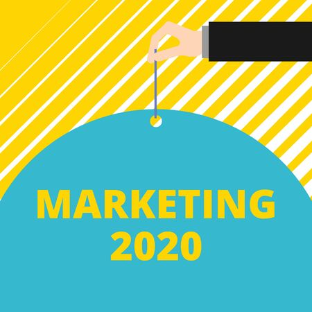 Text sign showing Marketing 2020. Business photo showcasing Commercial trends for 2020 New Year promotional event Man hand hold big half round paper tie string with thumb and index finger
