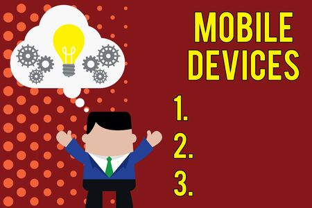 Writing note showing Mobile Devices. Business concept for A portable computing device like smartphone tablet computer Man hands up imaginary bubble light bulb working together