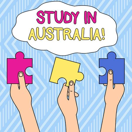 Writing note showing Study In Australia. Business concept for going into foreign country order complete your studies Three Colored Empty Jigsaw Puzzle Pieces Held in Different People Hands 写真素材