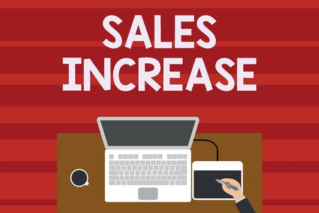 Text sign showing Sales Increase. Business photo text Grow your business by finding ways to increase sales Upper view laptop wooden desk worker drawing tablet coffee cup office