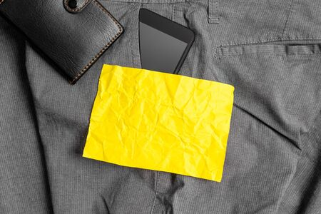 Smartphone device inside trousers front pocket with wallet and note paper 版權商用圖片