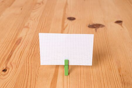 Empty reminder wooden floor background green clothespin groove slot office
