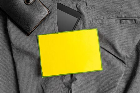 Smartphone device inside trousers front pocket with wallet and note paper 写真素材
