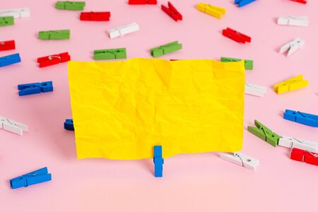 Colored clothespin papers empty reminder pink floor background office pin