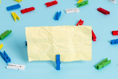 Colored clothespin papers empty reminder blue floor background office pin