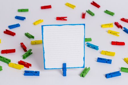 Colored clothespin papers empty reminder white floor background office