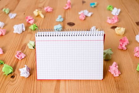 Colored crumpled papers empty reminder wooden floor spiral notebook office