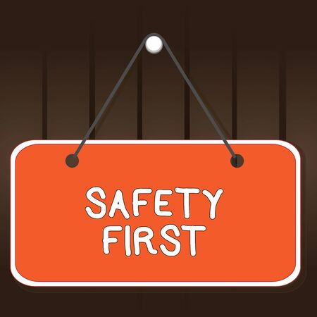 Writing note showing Safety First. Business concept for used to say that the most important thing is to be safe Memo reminder empty board attached background rectangle