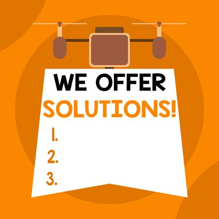 Writing note showing We Offer Solutions. Business concept for way to solve problem or deal with difficult situation Drone holding downwards banner. Geometrical abstract background design 写真素材