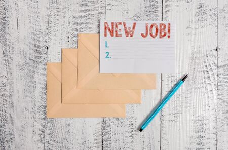 Text sign showing New Job. Business photo showcasing recently having paid position of regular employment Three envelopes marker ruled paper sheet old wooden vintage background