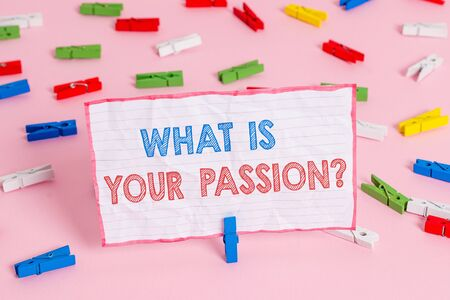 Text sign showing What Is Your Passion Question. Business photo text asking about his strong and barely controllable emotion Colored clothespin papers empty reminder pink floor background office pin