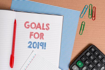 Word writing text Goals For 2019. Business photo showcasing object of demonstratings ambition or effort aim or desired result Striped paperboard notebook cardboard office study supplies chart paper