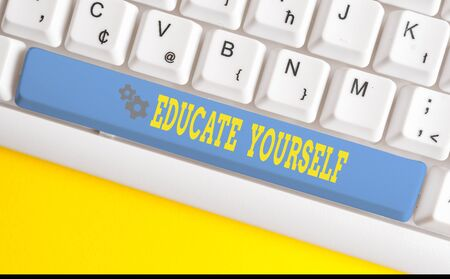 Text sign showing Educate Yourself. Business photo text prepare oneself or someone in a particular area or subject White pc keyboard with empty note paper above white background key copy space Stock Photo