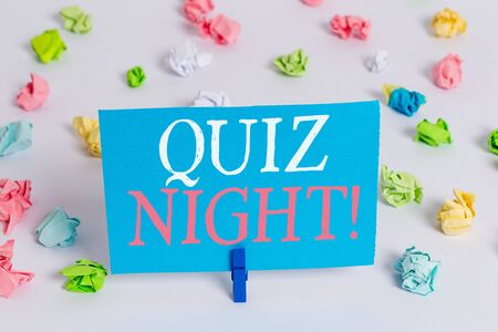 Writing note showing Quiz Night. Business concept for evening test knowledge competition between individuals Colored crumpled paper empty reminder white floor clothespin