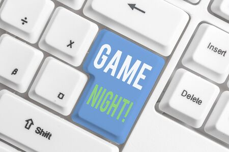 Word writing text Game Night. Business photo showcasing usually its called on adult playdates like poker with friends White pc keyboard with empty note paper above white background key copy space