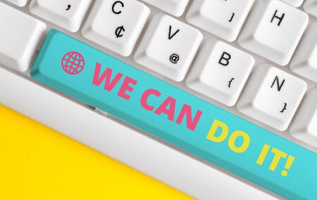 Conceptual hand writing showing We Can Do It. Concept meaning see yourself as powerful capable demonstrating White pc keyboard with note paper above the white background Foto de archivo - 128685980