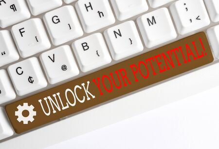 Conceptual hand writing showing Unlock Your Potential. Concept meaning release possibilities Education and good training is key White pc keyboard with note paper above the white background
