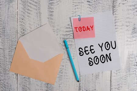 Writing note showing See You Soon. Business concept for used for saying goodbye to someone and going to meet again soon Envelope blank sheet sticky note ballpoint wooden background