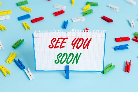 Text sign showing See You Soon. Business photo showcasing used for saying goodbye to someone and going to meet again soon Colored clothespin papers empty reminder blue floor background office pin