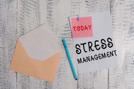 Writing note showing Stress Management. Business concept for method of limiting stress and its effects by learning ways Envelope blank sheet sticky note ballpoint wooden background