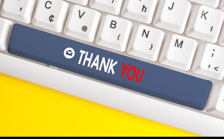 Word writing text Thank You. Business photo showcasing a polite expression used when acknowledging a gift or service White pc keyboard with empty note paper above white background key copy space Stockfoto