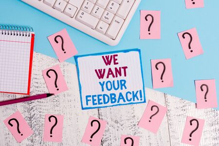 Writing note showing We Want Your Feedback. Business concept for criticism given someone say can be done for improvement Writing tools and scribbled paper on top of the wooden table